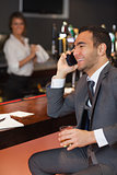 Smiling businessman having a phone call
