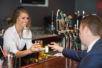 Beautiful waitress serving handsome businessman