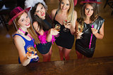 Happy gorgeous women holding flutes of champagne having hen party