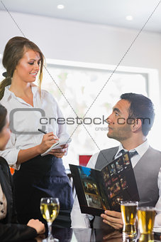 Businessman ordering a dinner from waitress