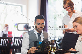 Two business people ordering dinner