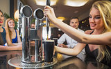 Attractive woman pulling a pint of stout