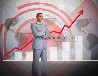 Attractive businessman standing in front of graphics