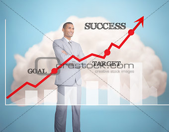 Smiling businessman standing behind graphics