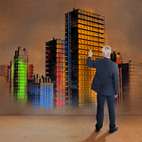 Rear view of businessman touching colorful city