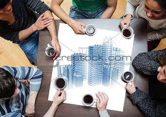 Overhead view of people sitting around table