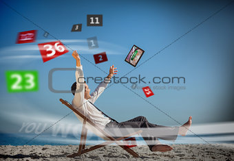 Businessman sitting on deck chair looking at holographic numbers