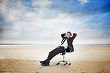 Young businessman sitting on swivel chair