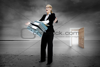 Shocked businesswoman dropping folders