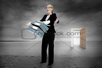 Shocked businesswoman dropping folders