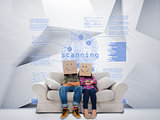 Couple with cartons on head sitting on couch under blue holographic finger print