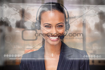 Attractive smiling businesswoman using futuristic interface hologram
