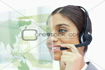 Attractive cheerful businesswoman using futuristic map interface