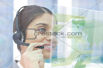 Beautiful cheerful businesswoman using futuristic map interface