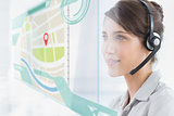 Happy call center employee using futuristic street map interface
