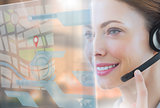 Happy call center employee looking at futuristic interface hologram