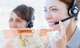 Attractive call center employee looking at futuristic interface hologram