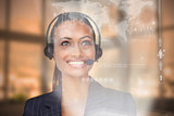 Smiling pretty businesswoman looking at futuristic interface hologram