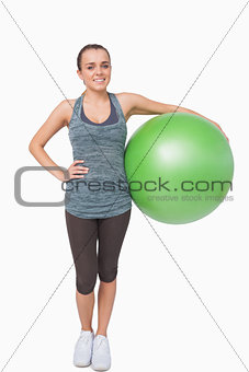 Cute young woman holding a fitness ball