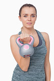 Beautiful young woman training with a kettle bell