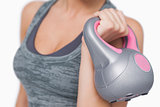 Close up of young woman training with kettle bell