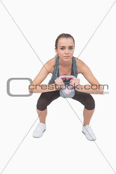 Attractive fit woman working with a kettle bell