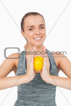 Content woman holding a massage ball between her hands