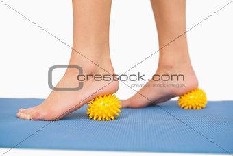 Close up of female feet touching massage ball