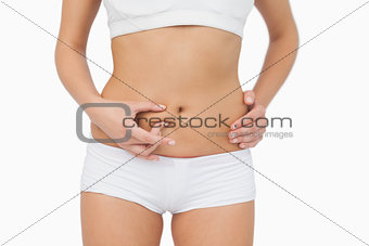 Slim young woman without any fat on her belly