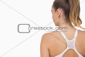 Rear view of ponytailed young woman wearing a sports bra