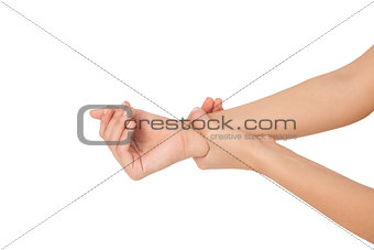 Close up of a young woman touching her wrist