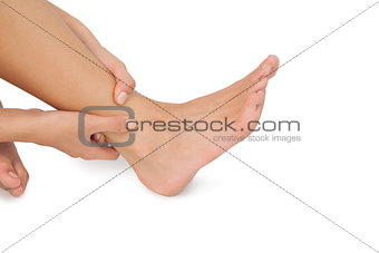 Close up of woman touching her injured foot