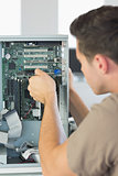 Computer engineer repairing computer