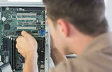 Computer engineer examining computer