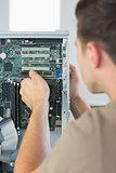 Computer engineer repairing open computer