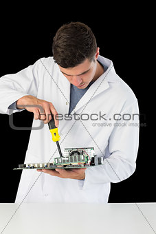 Attractive computer engineer repairing hardware at night