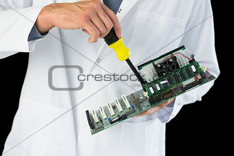 Close up of computer engineer repairing hardware at night