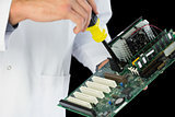 Extreme close up of computer engineer repairing hardware at night