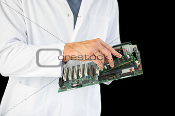 Close up of computer engineer holding hardware at night