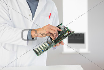 Close up of computer engineer holding hardware