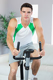 Handsome man training on exercise bike