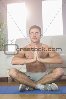 Calm handsome man meditating