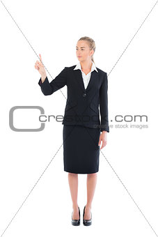 Young blonde business woman pointing