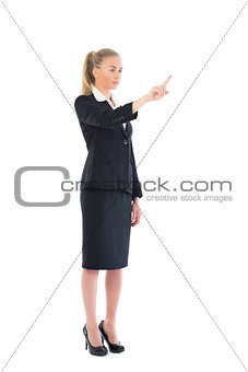 Side view of attractive blonde woman pointing
