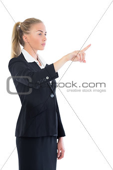 Side view of beautiful blonde businesswoman pointing