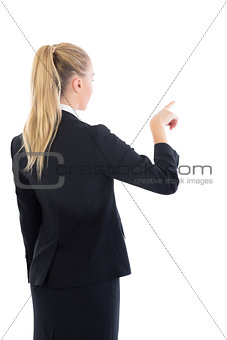Blonde businesswoman pointing