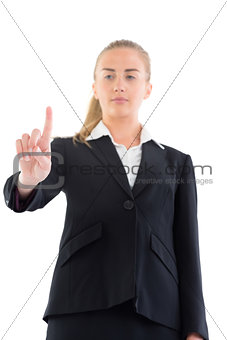 Low angle view of young businesswoman pointing