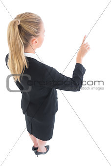 High angle view of young business woman pointing