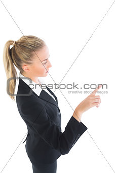 Blonde ponytailed business woman pointing