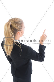 Attractive ponytailed business woman pointing